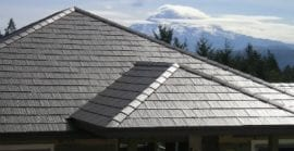 New dark grey rubber roofing on a home.