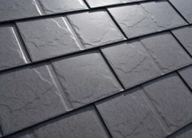 Closeup on a black clay tile roof.